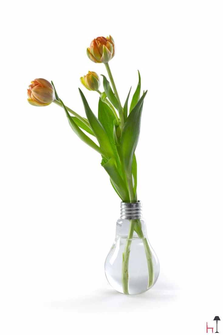 This original bulb-shaped vase is made from clear glass.