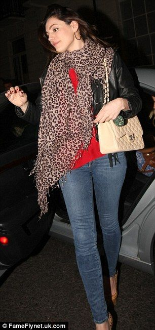 Kelly Brook mixes up her styles as she pairs gym leggings and trainers with a bouclé jacket and Chanel bag   Daily Mail Online