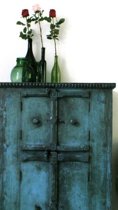 Deep teal colored with black furniture I love.
