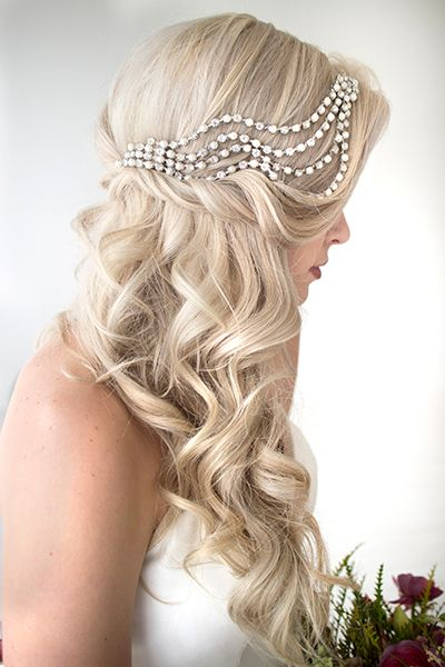 One of the most creative half-up hairstyles to date — check out that dazzling Art Deco crystal accessory!