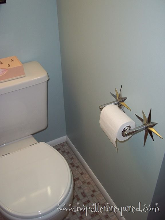 Starburst toilet paper holder