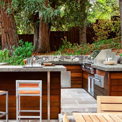 How do you like this contemporary outdoor kitchen with ipe cabinetry? | Photo: Michele Lee Willson/Arterra Landscape Architects | thisoldhouse.com |