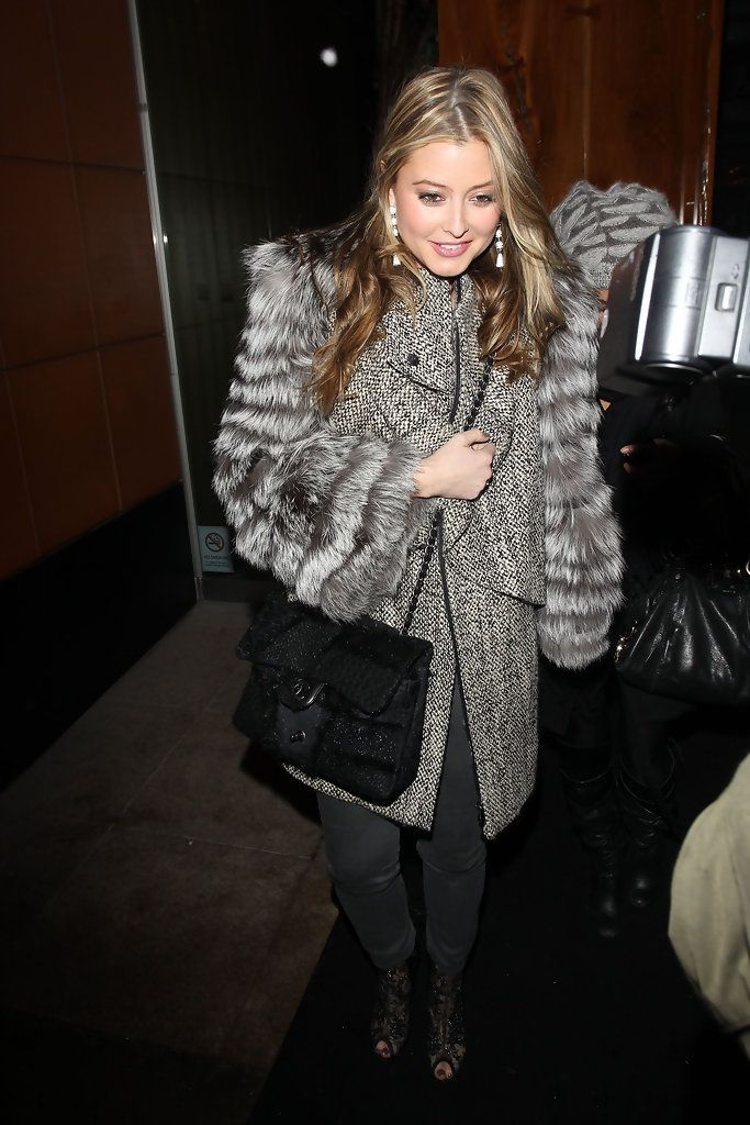 Holly Valance Chain Strap Bag - Holly Valance decked herself out in fur, matching a furry coat with a Chanel black fur purse.