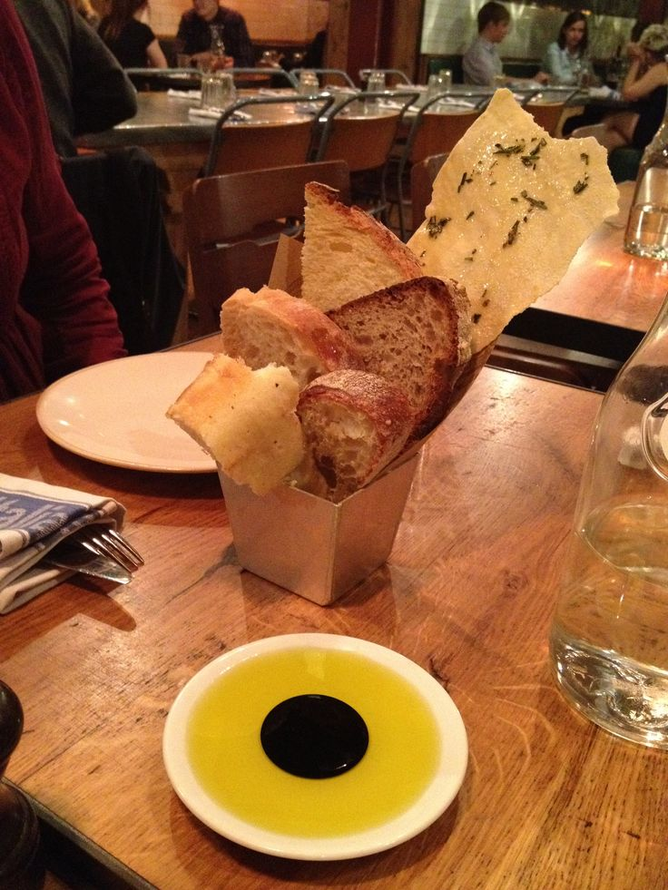 """A starter at Jamie Oliver's restaurant """"Jamie's Italian"""" in Covent Garden, London. Different kinds of bread with an olive oil and balsamic vinegar dip. Loved it!"""