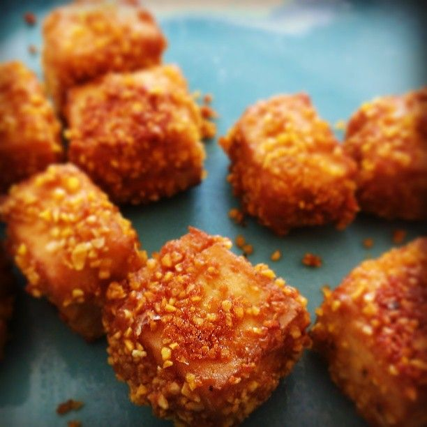 Baked crunchy tofu! Just toss tofu cubes with tamari, garlic, and cornmeal. Spray with olive oil and bake til golden and crisp. Easy peasy delish!