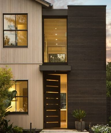 steel windows. vertical siding. like the window treatment too for protection from the sun.