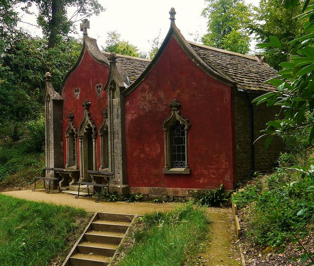 The 'Red House' - One of features of the elaborate Rococo Gardens of Painswick House was built in the mid 1730s - the owner, Charles Hyett, came to Painswick to escape the smog of Gloucester and named his new house 'Buenos Ayres'. Unfortunately, he died soon after and his son, Benjamin, created the fanciful garden (including this structure) in a hidden valley behind the house.