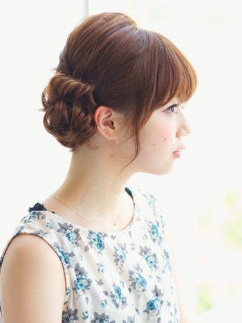 サイドスタイル。ダブルシニヨンのやさしい雰囲気が女性らしくて素敵です。