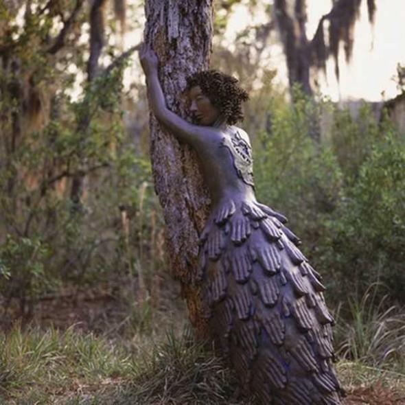 Woman hands dress hugging tree  Old moss secret woman's garden