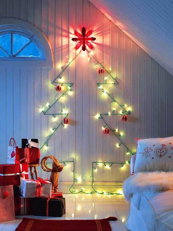 Garlands - the magic of Christmas lights...interesting idea for those who can't have a tree.  Love the white with the lights.