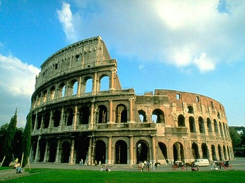 Colosseum in Rome, Italy. The largest amphitheatre ever built by the Roman Empire lies in the centre of Rome. It was built in 80 AD and big enough to seat 50,000 spectators. This theatre was a structure where comedies, dances, musical performances, gladiatorial contests, often immoral performances done (called striptease today).