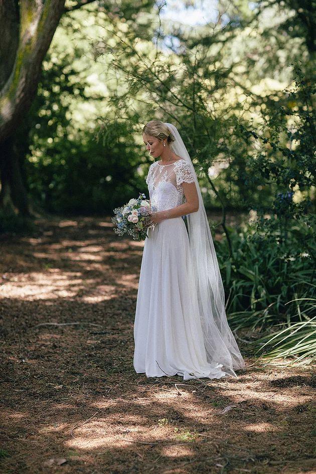 Jessie wearing custom Sophie Voon Bridal.
