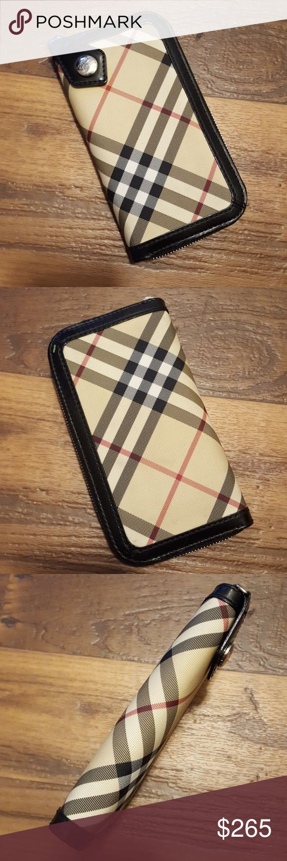 Authentic Burberry Zip wallet ✔price firm ✔This wallet is barely used 🚫no trades Dimensions are 7.5 inches x 4 inches It fits a Galaxy S6. Burberry Bags Wallets