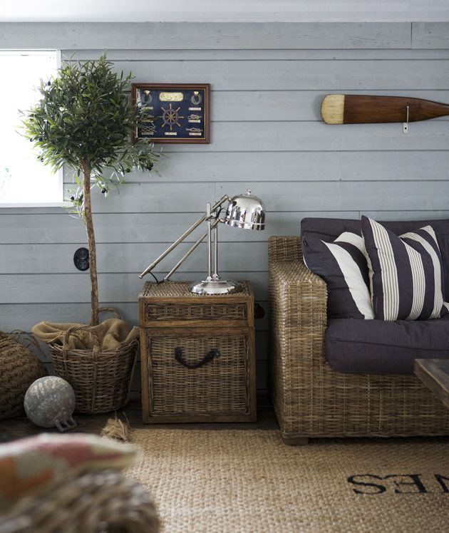 Rattan Sofa with cushions and pillows and coffin Artwood.  Lamp Slettwoll.  Coco Mat, Riviera Maison.