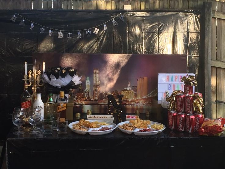 Birthday party buffet table New York themed black and gold