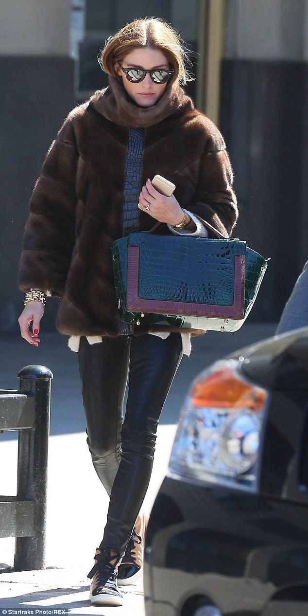 She's a style queen: Olivia looked cosy in her furry brown jacket and leather trousers, paired with some smart high top trainers