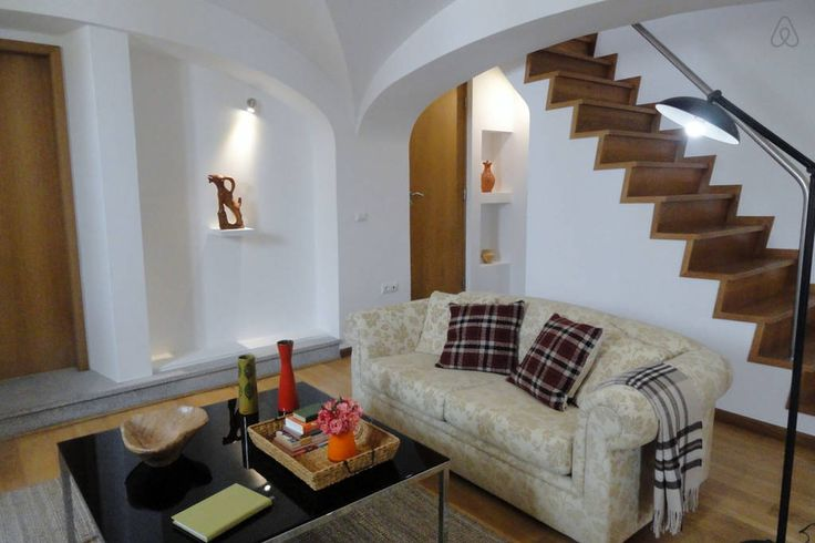Living room and stairs to terrace; Sala