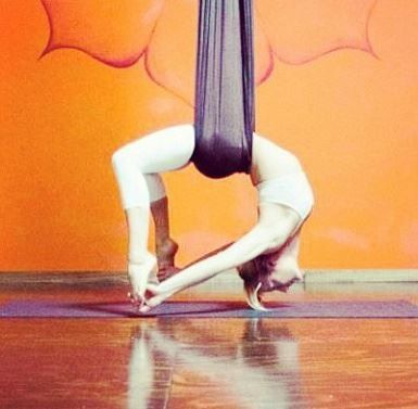 AIReal yoga uses a hammock as a tool to safely do inversions. #yoga #aerialyoga #bow airealyoga.com