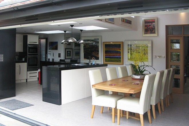 Open-Plan Kitchen with Bi-Fold Servery Window and Bi-Fold Doors that open up on to outside Entertaining Area