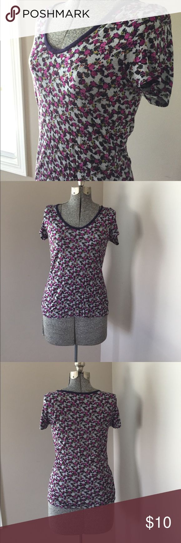 Gap floral tee shirt Gap floral T-shirt. Size small. Country blue with hot pink purple green and navy blue flowers. 100% rayon, stretchy and comfortable fabric.  In very good condition. GAP Tops Tees - Short Sleeve