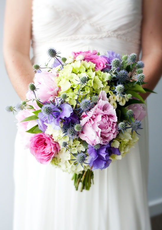 Gorgeous pink peonies, raspberry David Austin roses, button chrysanthemums, chincherinchee, pink bouvardia, green hydrangea, lavender, sweet pea, and blue thistle.