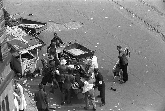 World War II. Liberation day. Wounded people at Dam square Amsterdam after German troops opened fire at the celebrating masses (22 killed, 120 injured) by Dutch photographer Wiel van der Randen, Amsterdam, The Netherlands, May 7, 1945. Nationaal Archief on flickr