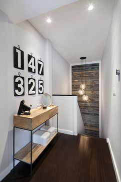 STAIRcase Reclaimed Wood Design Ideas - staircase wall of reclaimed wood in this contemporary/modern space.