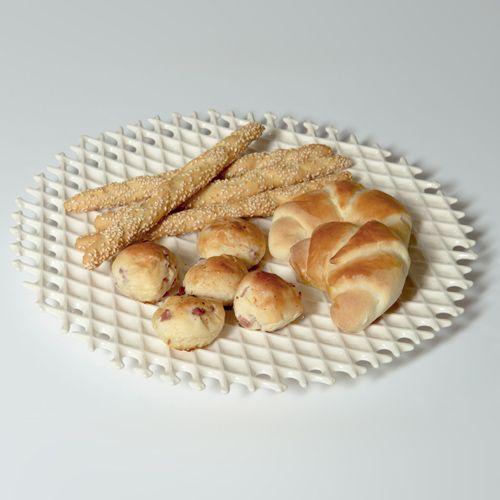 Breads sleeping on a Neola waffle dish, by Arago Design. #neola #waffle #design