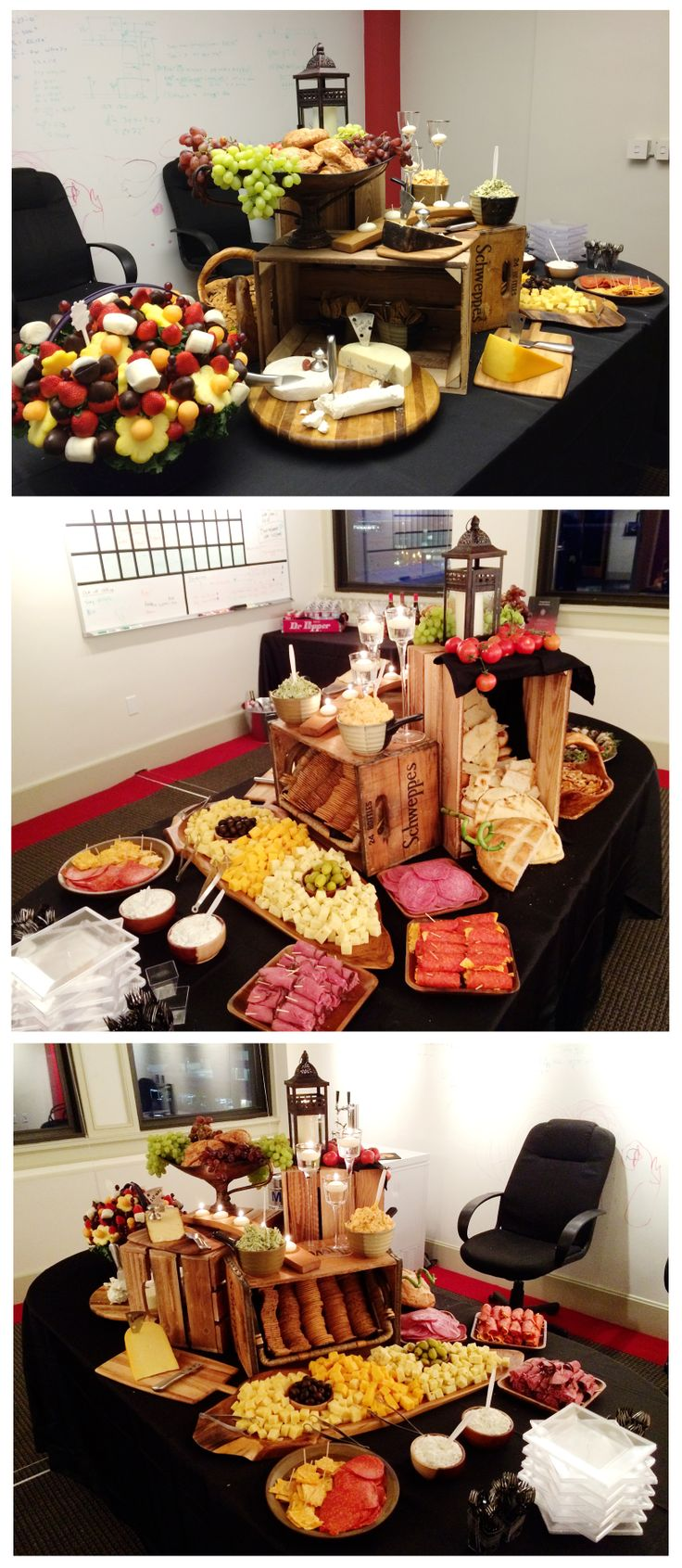 cheese and meat display, artisan catered hors d'oeuvres, rustic food tablescape . Setup with crates, glass candle holders, lantern, wood cheese trays, edible arrangement . We set this up for a company party, turned out great!