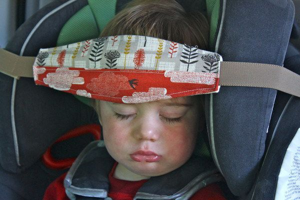 "A ""SlumberSling"" solves the problem of heavy heads and sore necks during nap time. 