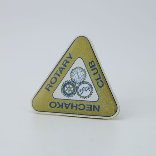 Printed lapel pin is perfect for designs with small, fine details. Like the three logos in the middle for example....