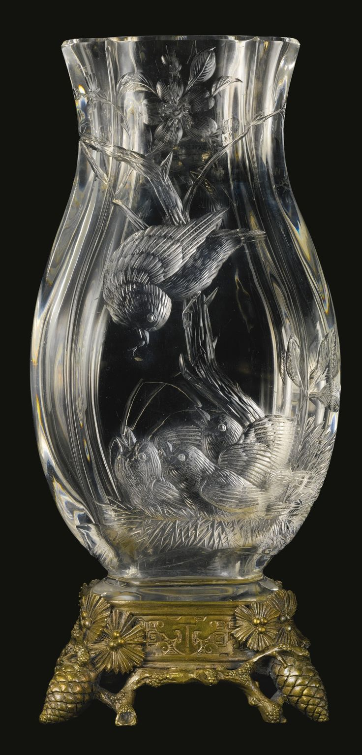CRISTALLERIE DE BACCARAT A JAPONISME SILVERED BRONZE MOUNTED CUT CRYSTAL VASE FRANCE, LATE 19TH CENTURY the front decorated with a bird feeding its nestlings,  stamped with the circular Baccarat logo to hardware height 12 1/4 in. 31 cm