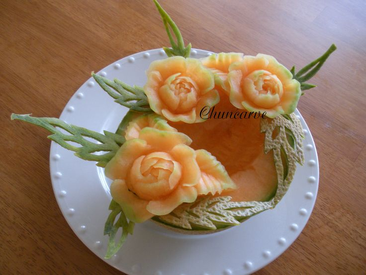 This fruit bowl was carved from cantaloupe garnish with melon peel to serve as a fruit bowl.