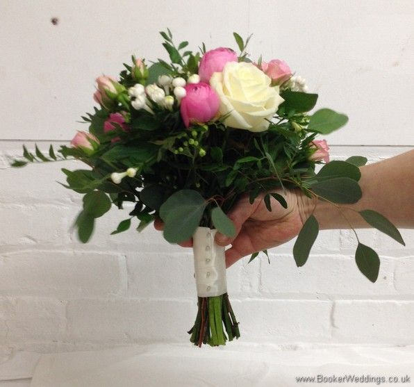 Semi-wild pale pink and cream Bridesmaid Bouquet with roses, ranunculus, bouvardia, spray roses and eucalyptus side view  Wedding Flowers Liverpool, Merseyside, Bridal Florist, Booker Flowers and Gifts, Booker Weddings