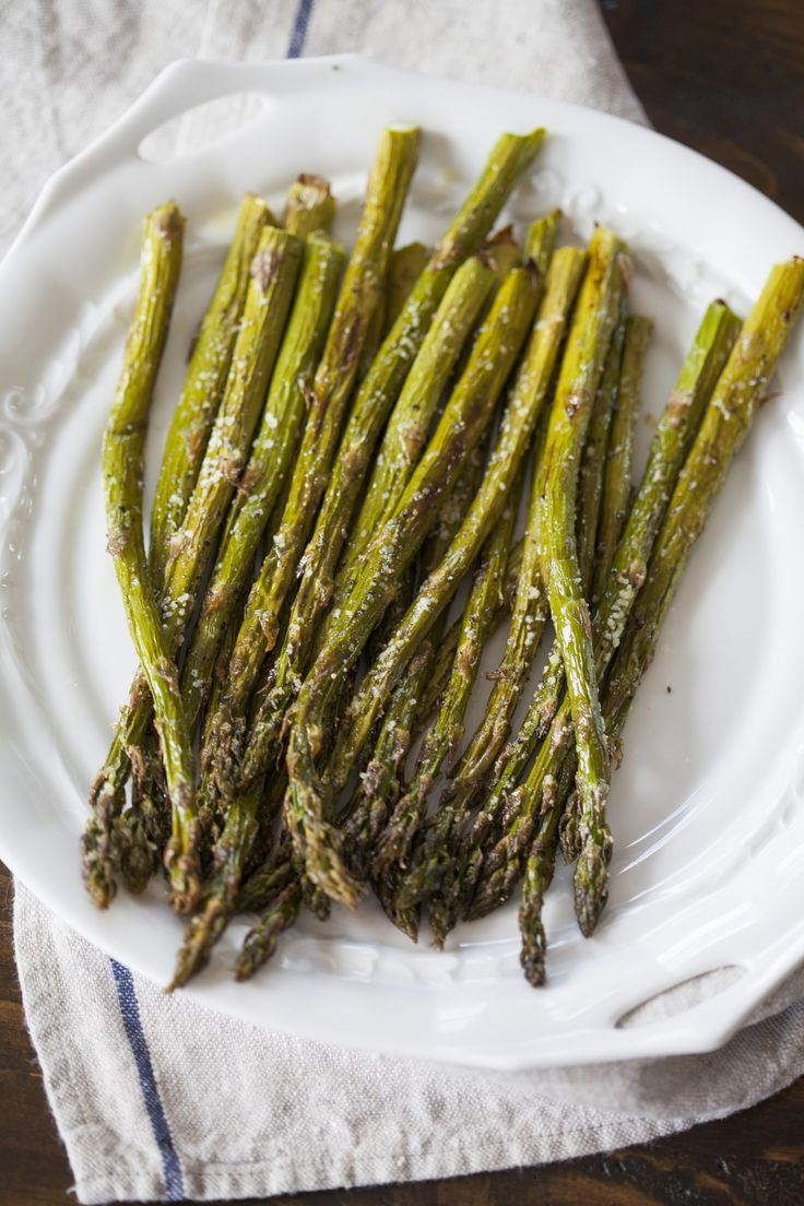 We can't get enough of asparagus this time of year. Did you know that asparagus grows 6 to 10 inches a day during peak growing season? We've been eating asparagus every which way — sautéed, blanched, even raw. But one of our favorite easy ways to prepare asparagus is to roast it in the oven. This is so easy; here's how to do it.