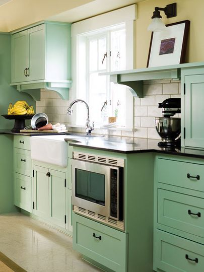 Benjamin Moore Paints: The trim, bench seat, and table legs are Seashell; cabinets are Salisbury Green; walls are Light Khaki.