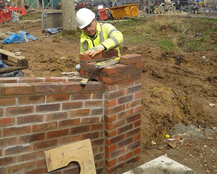 Construction of Gennets Bridge Lock. Building one of the piers at the end of the parapet wall.