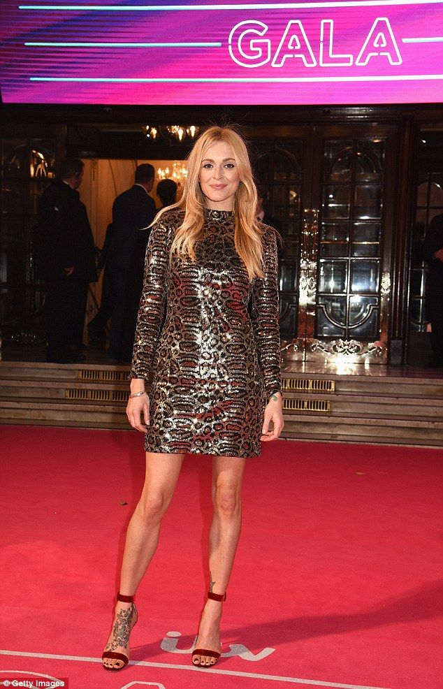 Sky's the limit: Fearne added height to her frame with a pair of sky-high strappy scarlet stilettos as she worked her magic in front of the cameras
