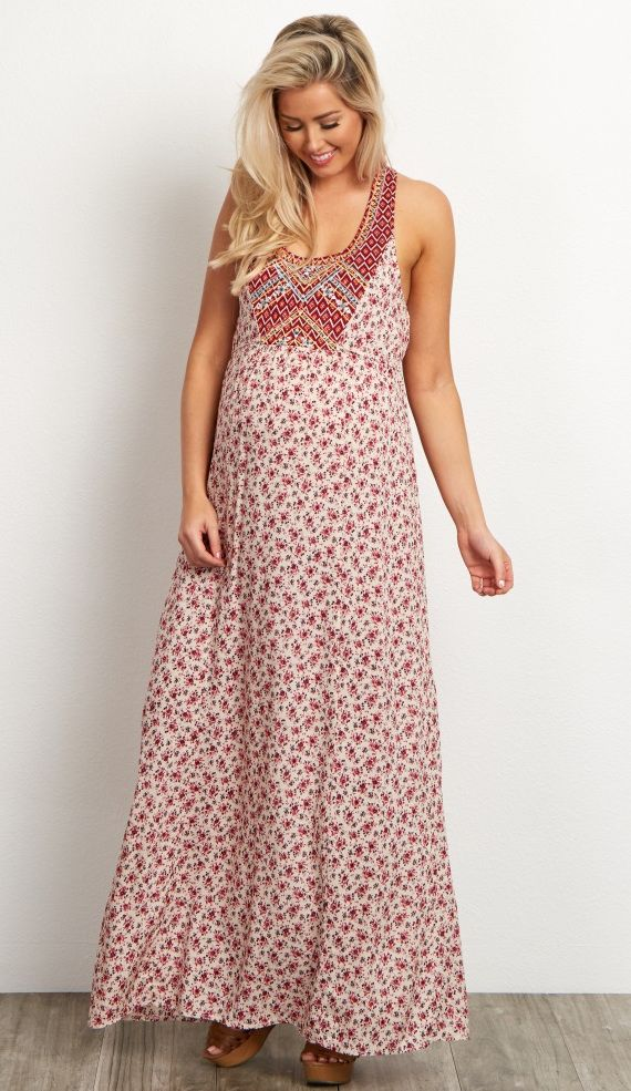 Bring the brights of summer to your wardrobe with this vibrantly printed floral maternity maxi dress! The lightweight, flowing material will give you a flirty and fun look to stay comfortably stylish in all season long while the neon embroidered accents give you a pop of color. For any occasion, you can dress this number up or down with the right accessories.
