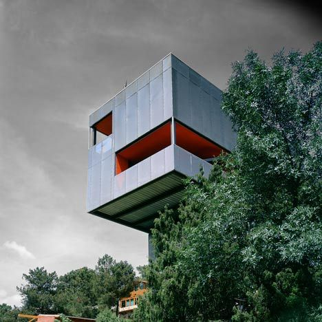 This metal house on stilts by Spanish architect Arturo Franco projects over a river valley in central Spain.