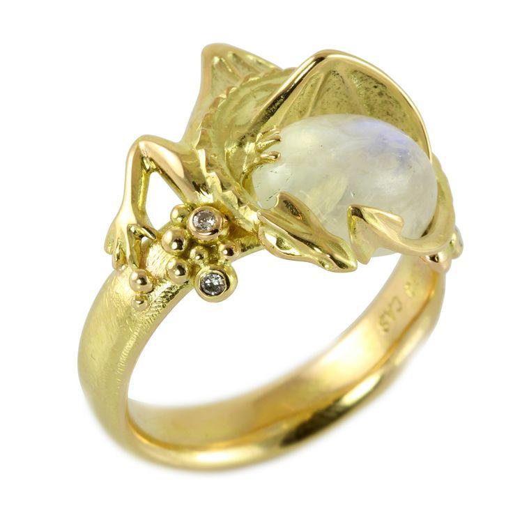 #gold #ring #huge #dragon #smaug #arkenstone #gameofthrones #thehobbit #lordoftherings #fairytale #motherofdragons #DaenerysTargaryen #diamonds #moonstone #gemstones  Beautiful gold dragon ring with a white moonstone with a blue shine.