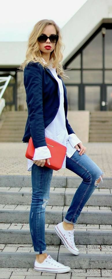 Cuffed skinny jeans, long white button-down tunic, navy blazer, sneakers, red clutch