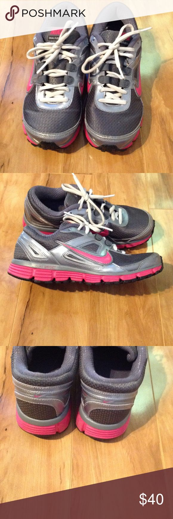 Nike dual fusion st sneakers Nike dual fusion sneakers. Pink, silver and grey.  Size 7.5. Only worn indoors and to and from car. Nike Shoes Athletic Shoes