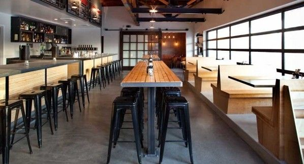 restaurant community tables | These gunmetal barstools paired with this bronze wall sconce are ...