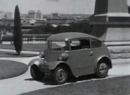 Bowker Electric Car. An early model electric car being driven through the streets of Adelaide in the early 1940s.