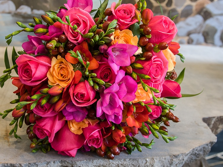 Jewel-toned bridal bouquet of roses and freesia