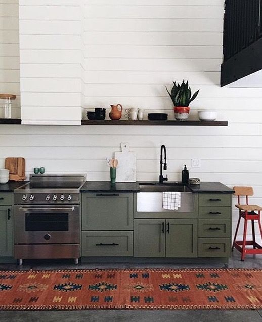 Love the green cabinets.