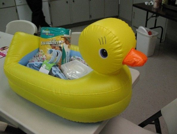 Rubber Ducky Pool Float Filled With Bath Time Presents.