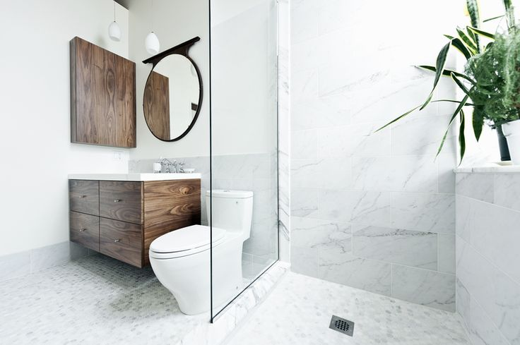 """What could I have that would feel luxurious, would make me feel really great?"" muses one of the homeowners. ""My husband and I travel a lot in Europe, and we always loved the marble showers. So we put a marble shower up against the window."" The sink and countertop are from Batimat, while the wall-hung vanity is another custom piece by Gepetto."