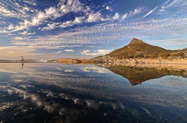"Check out more sweet pics like these, who made them, and the stories behind them: instagram.com/capetownmag. Are you on Instagram? Tag one of your great pics with #CapeTownMag and we might just feature your image. The picture of the week for the winning #capetownmag feature!   ""A lone figure appreciates an epic summer sky from the #campsbay tidal pool.""  featuring @morrowsteven"